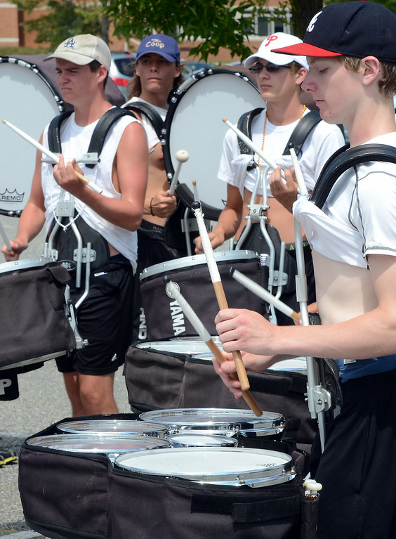 Description of . The North Penn High School Marching Knights percussion section rehearse during band camp at the school  on Tuesday afternon August 19,2014. Photo by Mark C Psoras/The Reporter
