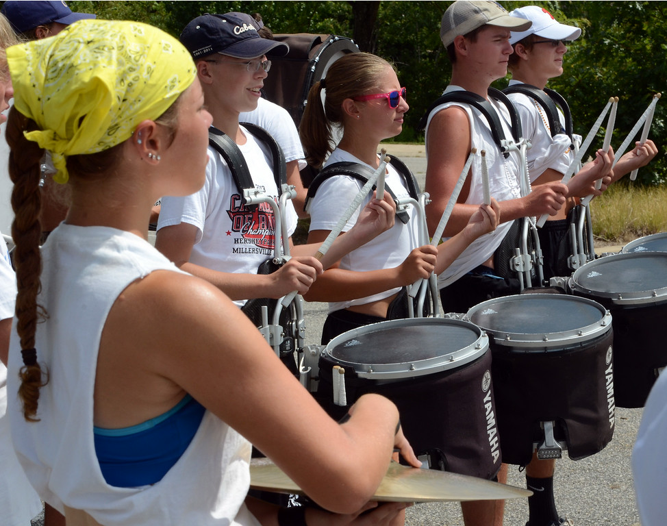 Description of . The North Penn High School Marching Knights percussion section rehearses during band camp at the school  on Tuesday afternon August 19,2014. Photo by Mark C Psoras/The Reporter
