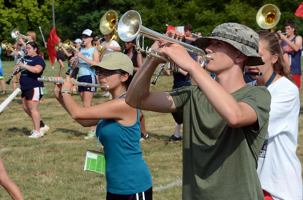Description of . The North Penn High School Marching Knights rehearse during band camp at the school  on Tuesday afternon August 19,2014. Photo by Mark C Psoras/The Reporter