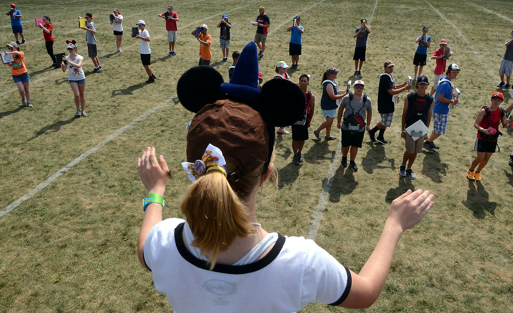 Description of . Drum Major Sara Mack leads the Souderton Area High School Big Red Marching Band as they rehearse during band camp at the school on Tuesday afternon August 19,2014. Photo by Mark C Psoras/The Reporter