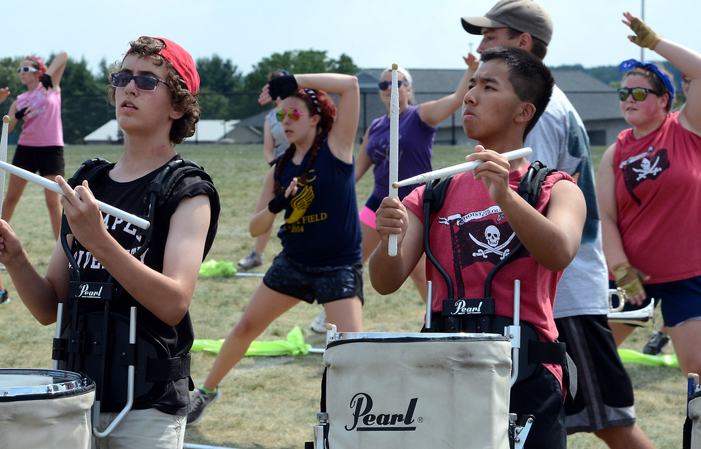 Description of . The Souderton Area High School Big Red Marching Band rehearse during band camp at the school on Tuesday afternon August 19,2014. Photo by Mark C Psoras/The Reporter