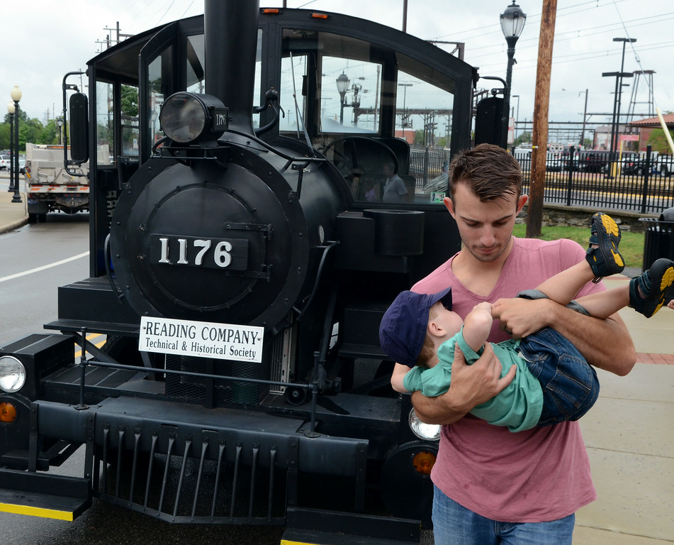 Description of . Families check out a miniature train of the Reading Company Technical & Historical Society during the Lansdale Founders Day  celebration and on Saturday August 23,2014. Photo by Mark C Psoras/The Reporter