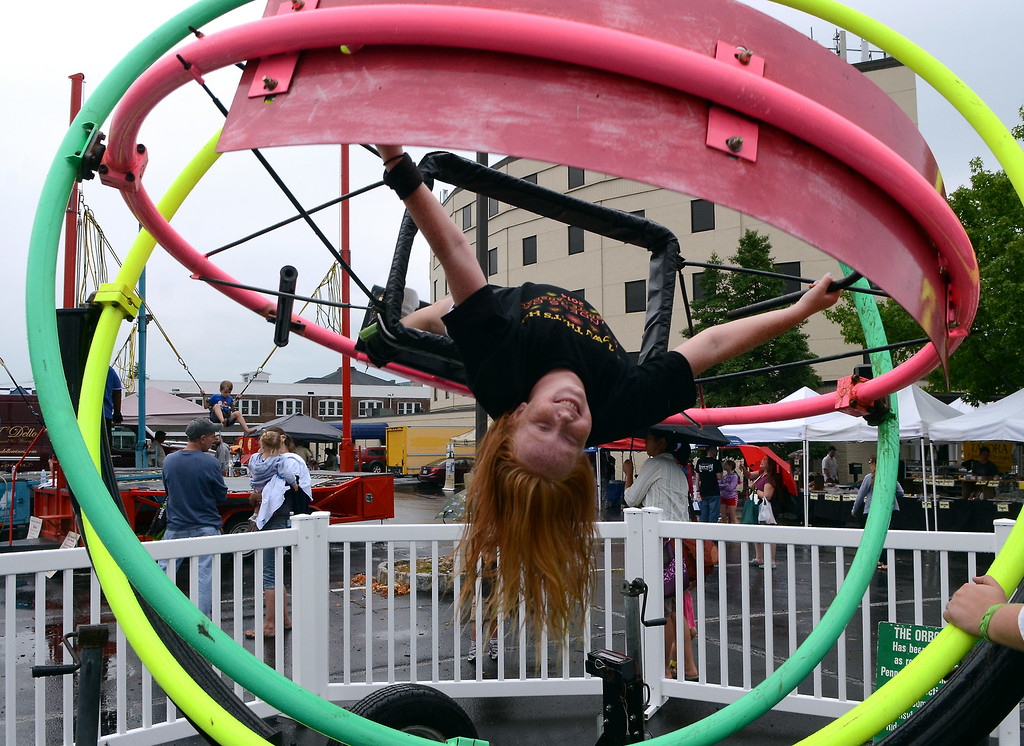 Description of . Ellie Schreiner ,11, enjoys a spin on a Orbotron during the Lansdale Founders Day  celebration and on Saturday August 23,2014. Photo by Mark C Psoras/The Reporter