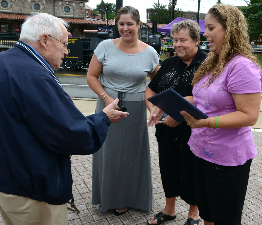 Description of . State Rep. Bob Godshall presents a proclamation to Dorothy Frederick (2nd from R) and her daughters Stephanie (L center) and Karen Diehl after the the Lansdale Borough Lifetime Achievement Award was presented to the late Stephen Frederick during the Lansdale Founders Day  celebration and on Saturday August 23,2014. Photo by Mark C Psoras/The Reporter