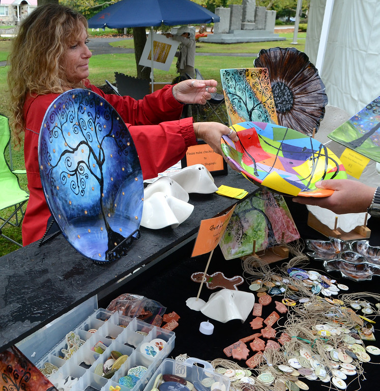 Description of . Artist Wendy Shupinski displays some of her works during the 26th Annual Lansdale Festival of the Arts in Memorial Park on Saturday August 23,2014. Photo by Mark C Psoras/The Reporter