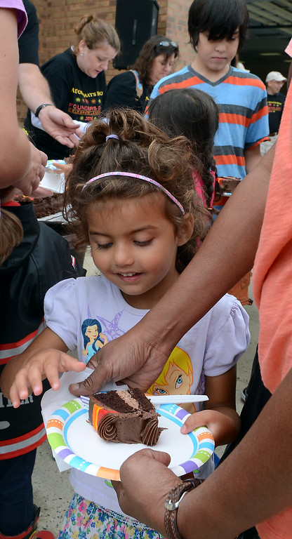 Description of . Children enjoy cake cut for the Fairmount Fire Company 125th Anniversary festivities during the Lansdale Founders Day celebration on Saturday August 23,2014. Photo by Mark C Psoras/The Reporter