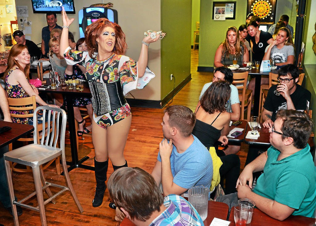 Description of . Drag queen Katrina Escalarza entertains the crowd during  a show at Round Guys Brewing Co. in Lansdale on Saturday June 22, 2014. Photo by Mark C. Psoras/The Reporter