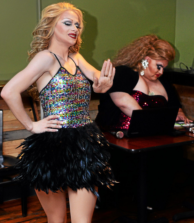 Description of . Drag queens Aida Snatchwell and Fanci DisMount entertain the crowd during a   show at Round Guys Brewing Co.in Lansdale on Saturday June 22, 2014. Photo by Mark C. Psoras/The Reporter