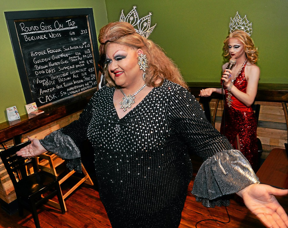 Description of . Fanci DisMount, in the foreground, and Aida Snatchwell, seen in the bacground, entertain the crowd at Round Guys Brewing in Lansdale on Saturday June 22, 2014. Photo by Mark C. Psoras/The Reporter