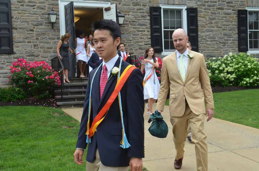 Description of . Germantown Academy High School graduates proceed to the field house for commencement ceremony.   Friday, June 13, 2013.  Photo by Geoff Patton