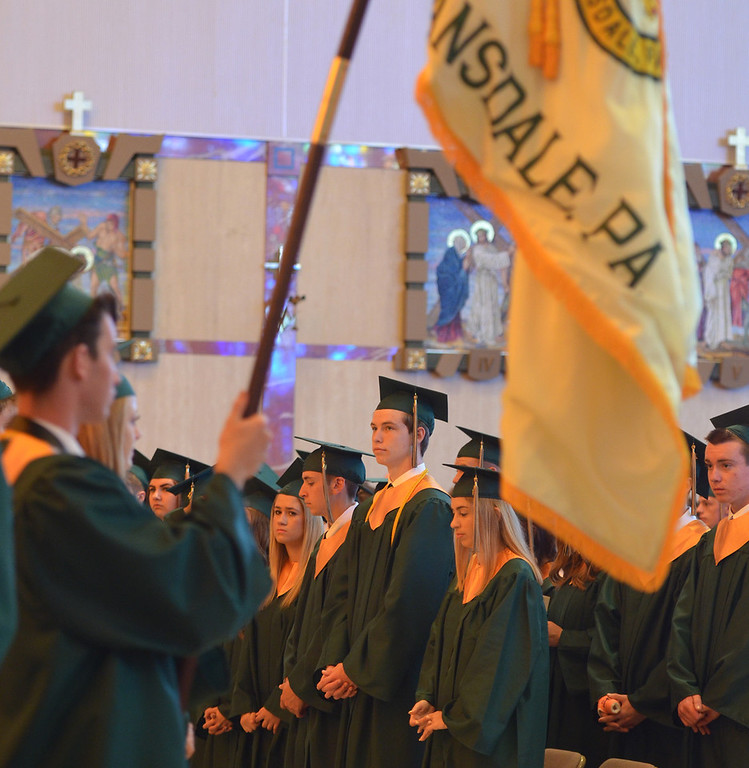 Description of . Lansdale Catholic high school seniors stand before being seated for commencement ceremony at the Shrine of Czestochowa.  Tuesday, June 3, 2014.  Photo by Geoff Patton