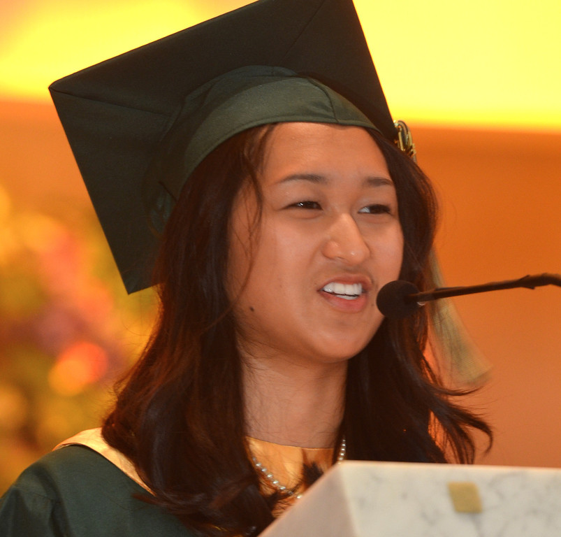 Description of . Pearl Valentine Guinto Galido delivers the Salutatorian Address at the Lansdale Catholic high school commencement ceremony.   Tuesday, June 3, 2014.  Photo by Geoff Patton