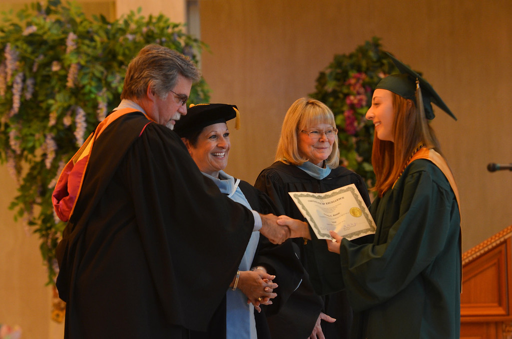 Description of . Awards are distributed at the Lansdale Catholic high school commencement ceremony.   Tuesday, June 3, 2014.  Photo by Geoff Patton