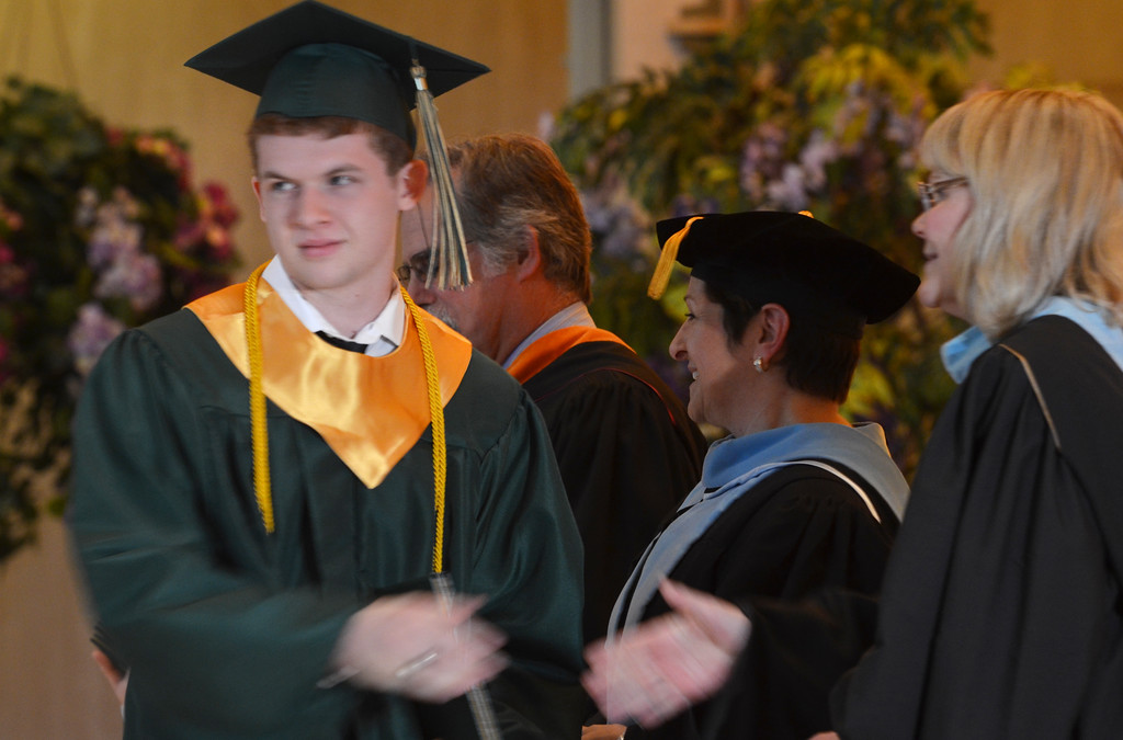 Description of . James Paul Canfield receives his diploma at the Lansdale Catholic high school commencement ceremony.   Tuesday, June 3, 2014.  Photo by Geoff Patton