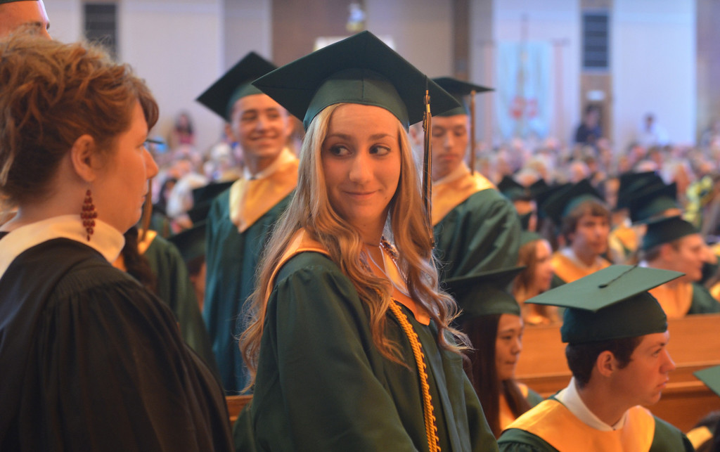 Description of . Michele Christine Doheny waits for her name to be called to receive her diploma at the Lansdale Catholic high school commencement ceremony.   Tuesday, June 3, 2014.  Photo by Geoff Patton