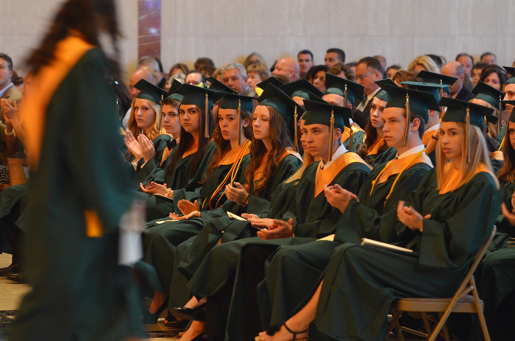 Description of . Seniors applaud as awards are distributed at the Lansdale Catholic high school commencement ceremony.   Tuesday, June 3, 2014.  Photo by Geoff Patton