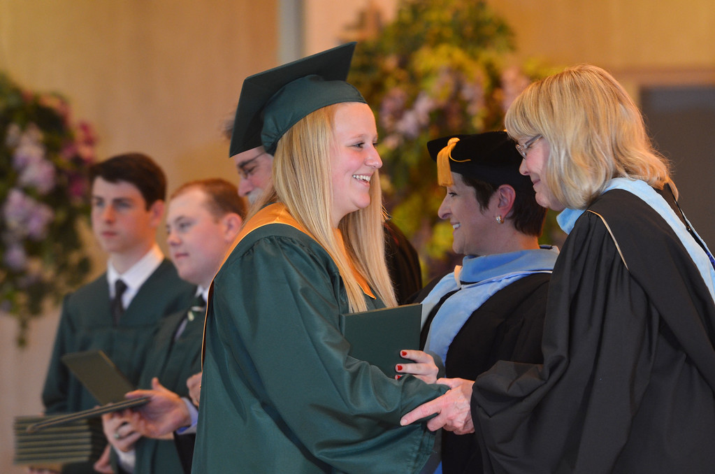 Description of . Meghan Ruth Heger receives her diploma at the Lansdale Catholic high school commencement ceremony.   Tuesday, June 3, 2014.  Photo by Geoff Patton