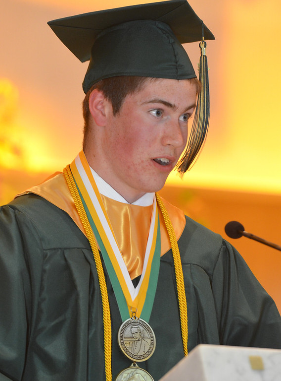 Description of . John Patrick Rogers delivers the Valedictory Address at the Lansdale Catholic high school commencement ceremony.   Tuesday, June 3, 2014.  Photo by Geoff Patton