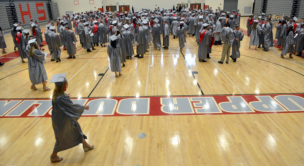 Description of . Upper Dublin High School Class of 2014 members line up in the gym before the start of  their Commencement Ceremony at the school on Tuesday evening June 10,2014. Photo by Mark C Psoras/The Reporter