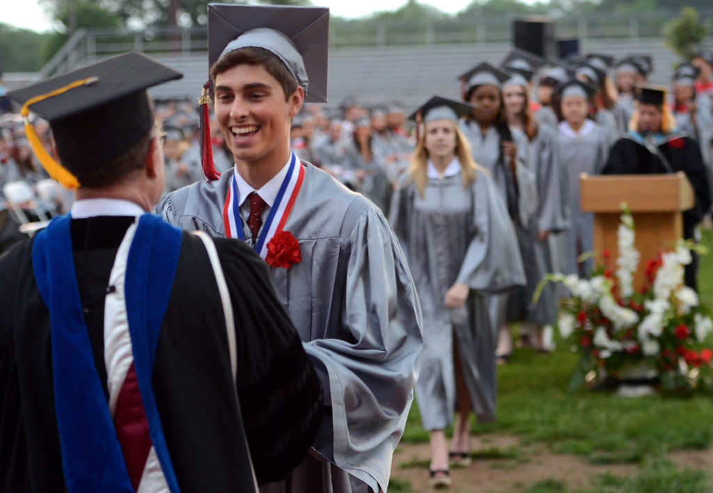 Description of . Upper Dublin High School Class of 2014 members recieve their diplomas during their Commencement Ceremony at the school on Tuesday evening June 10,2014. Photo by Mark C Psoras/The Reporter