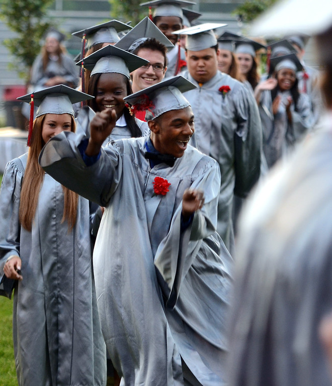 Description of . Upper Dublin High School Class of 2014 member Joezel Newman Jr. does a dance as he is announced to recieve his diploma during their Commencement Ceremony at the school on Tuesday evening June 10,2014. Photo by Mark C Psoras/The Reporter