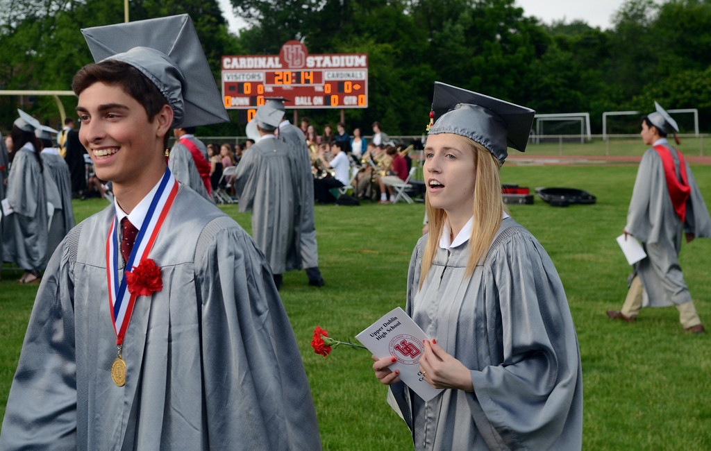 Description of . Upper Dublin High School Class of 2014 members march into the stadium for their Commencement Ceremony at the school on Tuesday evening June 10,2014. Photo by Mark C Psoras/The Reporter