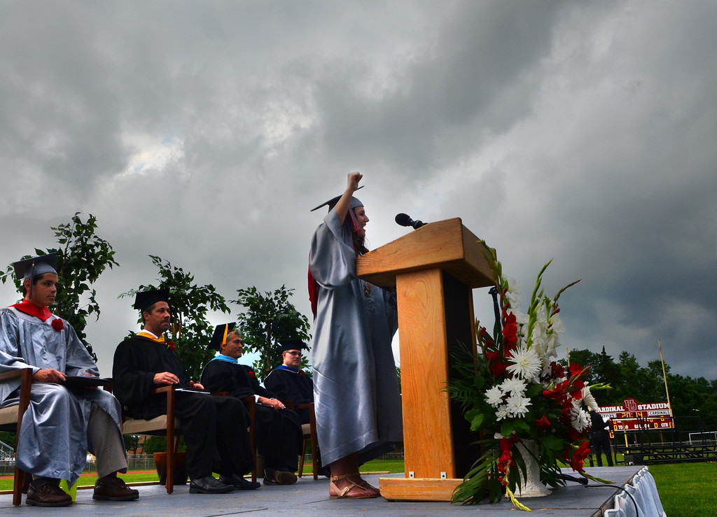 Description of . Upper Dublin High School Class of 2014 member Jenna Mandel gives the Greeting as storm clouds gather overhead during their Commencement Ceremony at the school on Tuesday evening June 10,2014. Photo by Mark C Psoras/The Reporter