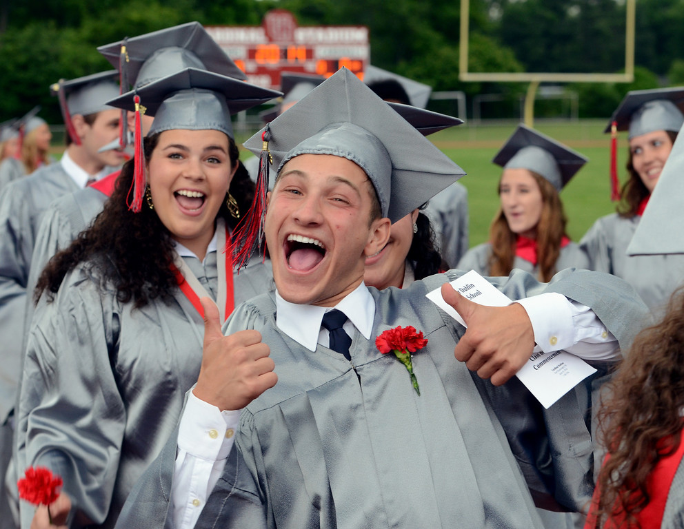 Description of . Upper Dublin High School Class of 2014 members joke around as they march into the stadium for their Commencement Ceremony at the school on Tuesday evening June 10,2014. Photo by Mark C Psoras/The Reporter