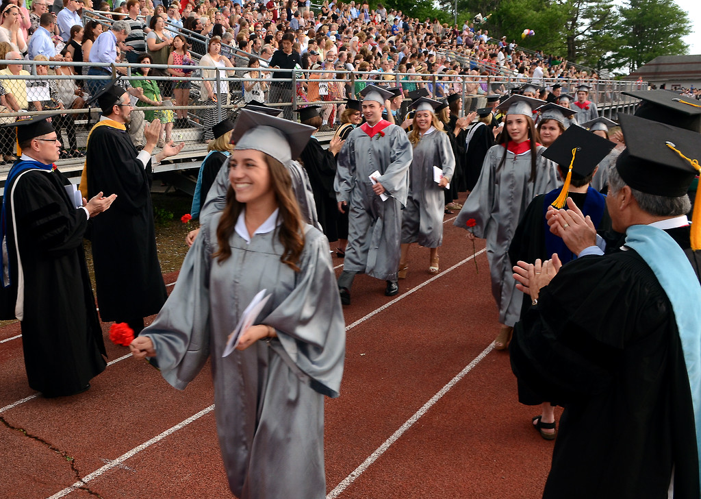 Description of . Upper Dublin High School Class of 2014 members are applauded as they march into the stadium for their Commencement Ceremony at the school on Tuesday evening June 10,2014. Photo by Mark C Psoras/The Reporter