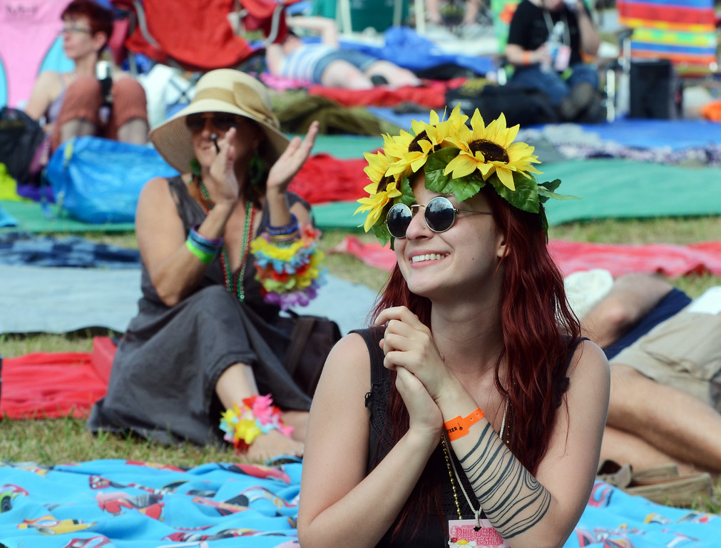 Description of . Audience members applaud at an afternoon performance at the Philadelphia Folk Festival.  Friday, August 15, 2014.   Photo by Mark C. Psoras