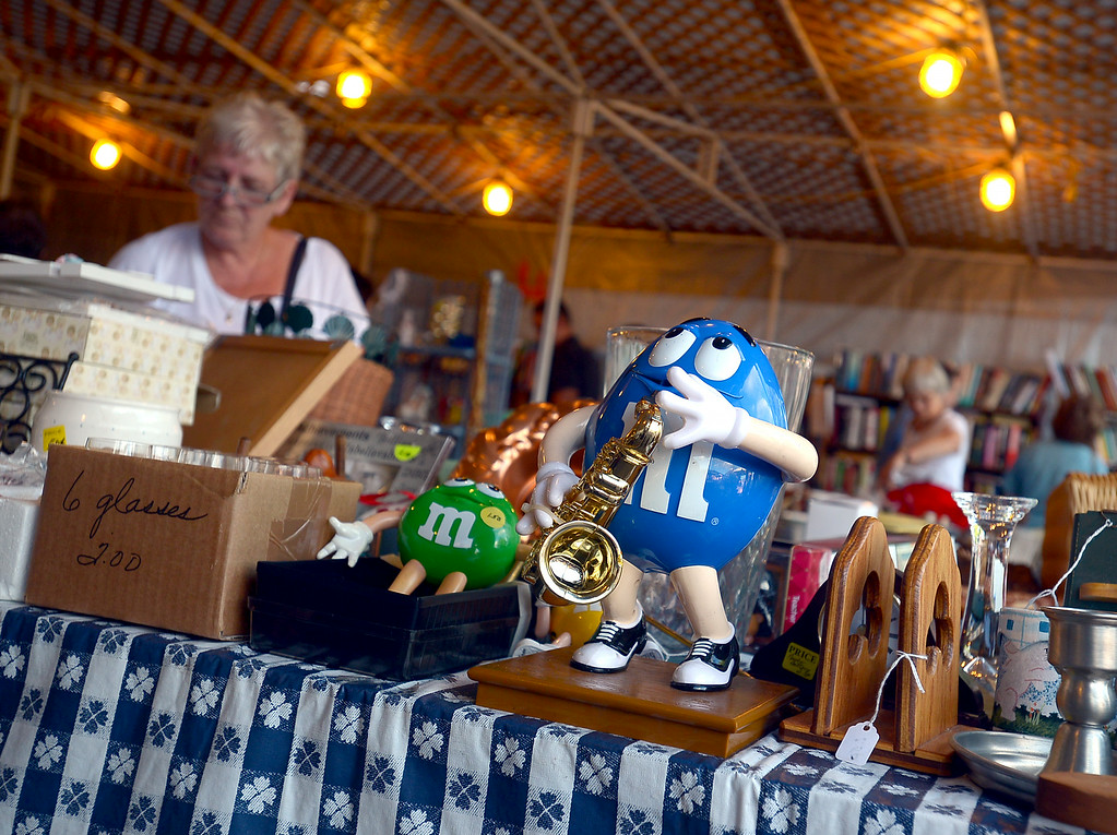 Description of . An M & M saxaphone player awaits purshase in the yard-sale tent at the St. Stanilaus Fair Wednesday, Aug. 13, 2014. Montgomery Media staff photo by Bob Raines