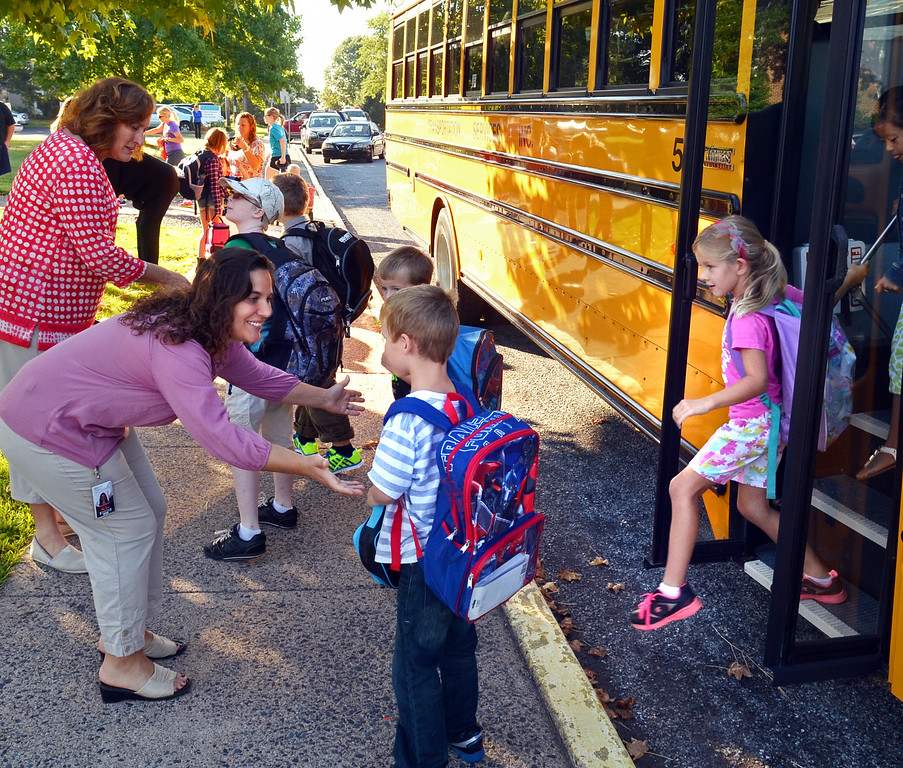Description of . Teachers welcome students at EM Crouthamel Elementary School in Souderton as the get off the bus on the first day.   Monday, August 25, 2014.   Photo by Geoff Patton