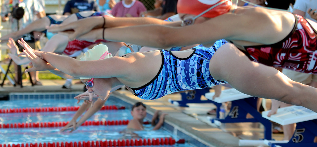 Description of . Katfield swimmer Julie Krout(center) along with teammates and  Harleysville competitors launch for a senior girls butterfly event during their meet  at the Harleysville Community Pool on Thursday July 17,2014.Photo by Mark C Psoras/The Reporter