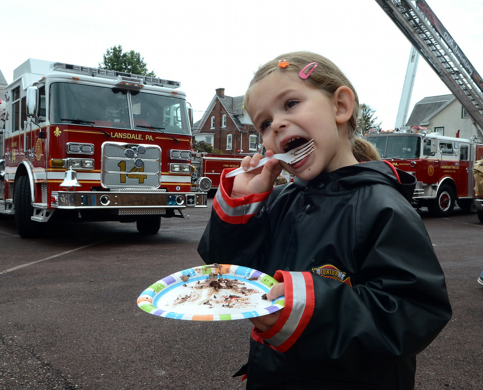 Description of . Esther Cerveny ,3, enjoys a piece of cake for the Fairmount Fire Company 125th Anniversary festivities during the Lansdale Founders Day celebration on Saturday August 23,2014. Photo by Mark C Psoras/The Reporter