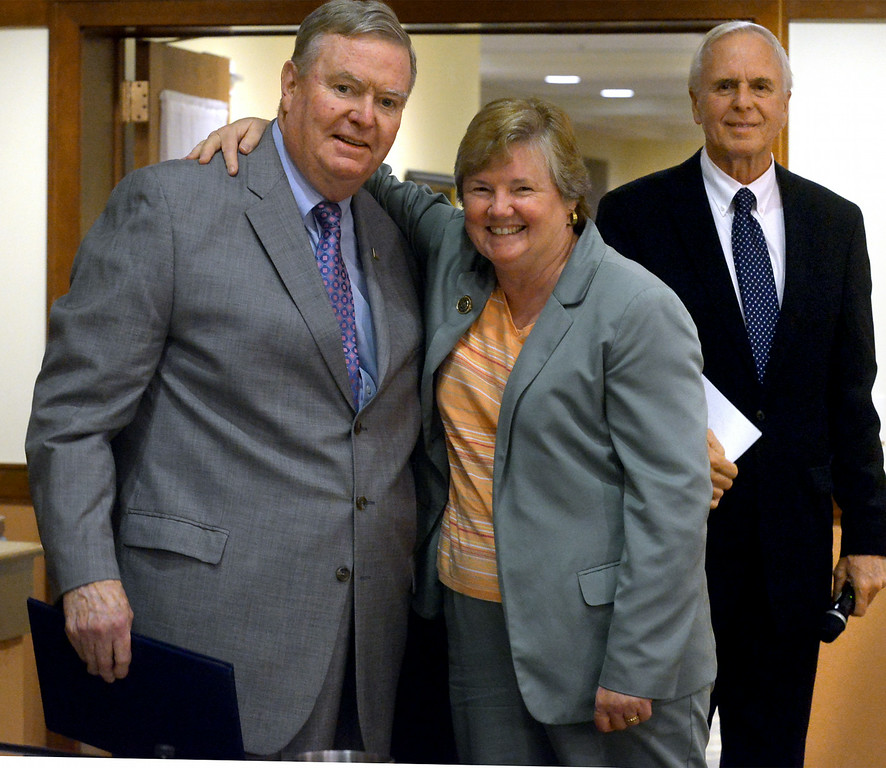 Description of . Lower Gwynedd Township Supervisor Ed Brandt receives a proclamation and a hug from  Pa. State Representative Kate Harper, who formerly served on the board with Brandt. State Senator Stewart Greenleaf, right, waits to present a proclamation from the Senate during a board of supervisors meeting held at Foulkeways Tuesday, Aug. 25, 2014. Montgomery Media staff photo by Bob Raines
