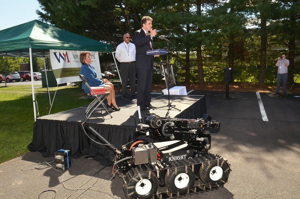 Description of . Representative (R-PA 8th District)  Mike  Fitzpatrick speaks during ceremony at WM Robots LLC in Colmar.  At left is Montgomery County Disrict Attorney Risa Ferman with WM Robot Chief Operating officer Gene Samsi.   Thursday, August 28, 2014.  Photo by Geoff Patton