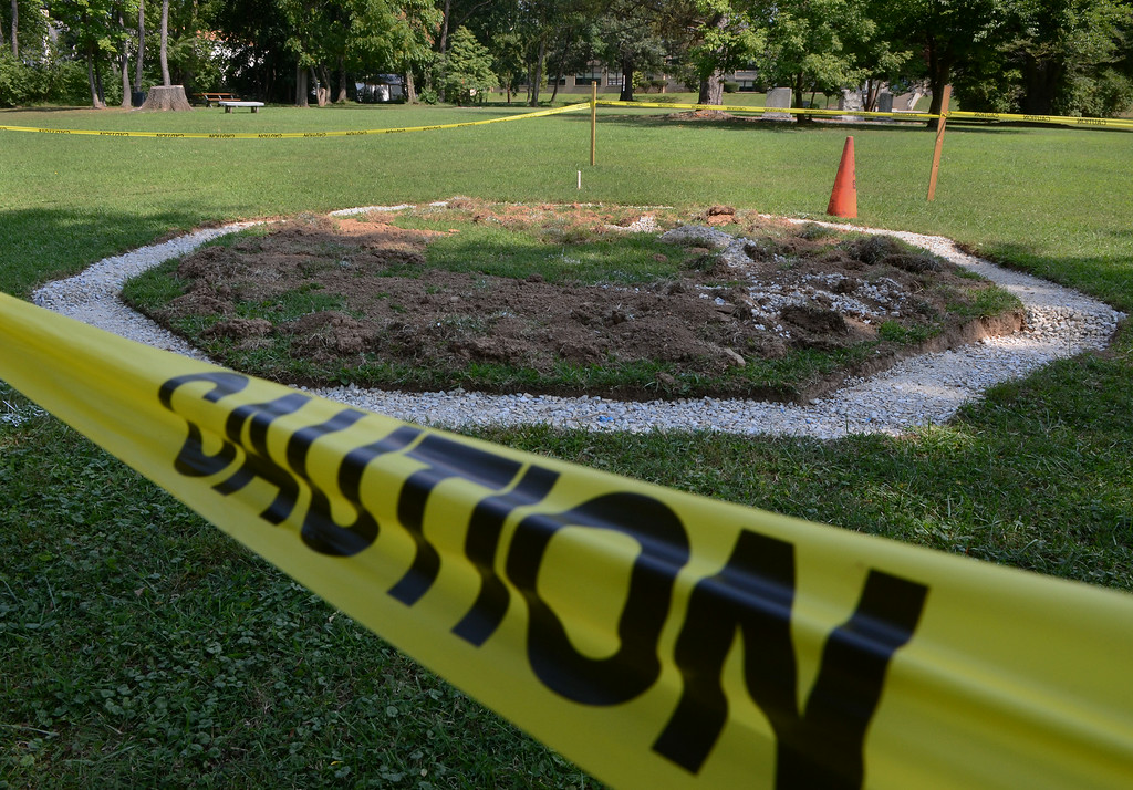 Description of . Caution tape surrounds the area in Weingartner Park in North Wales that is slated for a gazebo on Wednesday afternon August 27,2014. Photo by Mark C Psoras/The Reporter