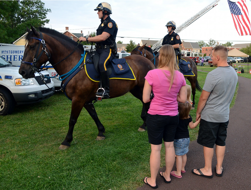 Description of . Bethlehem Police Department Mounted Patrol Unit Officers ride through Souderton Community Park during the Souderton and Telford Police Departments Community Night Out on Tuesday evening August 19,2014. Photo by Mark C Psoras/The Reporter