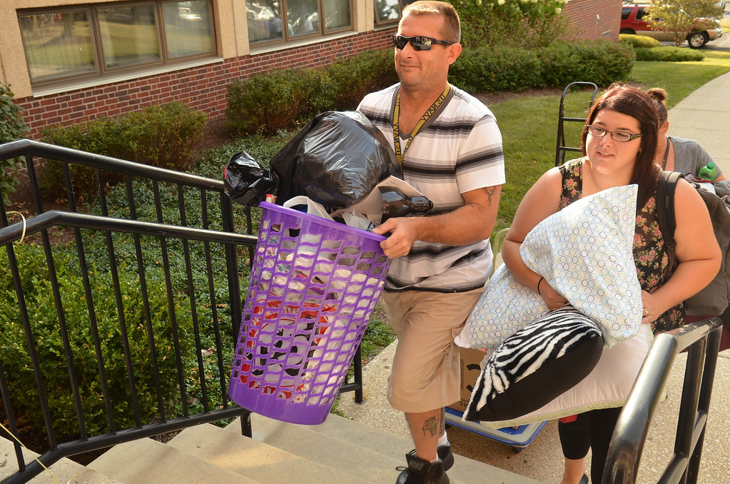 Description of . Education major Erin Pierson with her father Andy Pierson climbs the steps to a residence hall on move-in day at Gwynedd Mercy University.   Thursday, August 21, 2014.   Photo by Geoff Patton