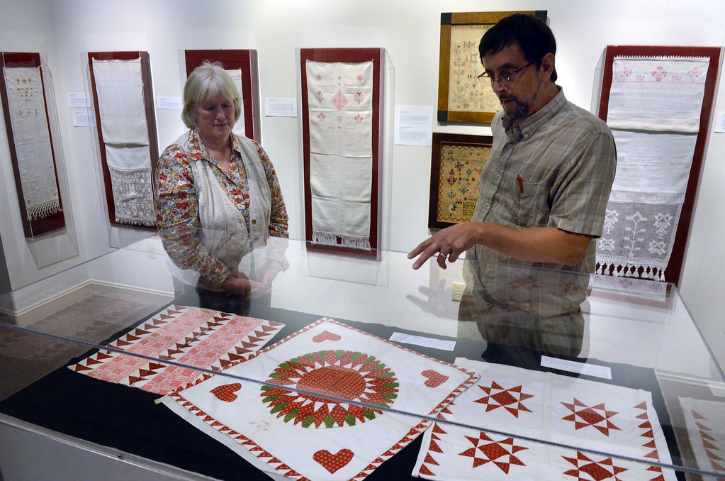 Description of . Mennonite Heritage Center Collections Manager Joel Alderfer and Director Sarah Heffner show some of the items displayed in the Common Threads exhibit (textiles from the Mennonite Heritage Center,Goschenhoppen Historians, and the Schwenkfelder Library & Heritage Center) Photo by Mark C Psoras/The Reporter
