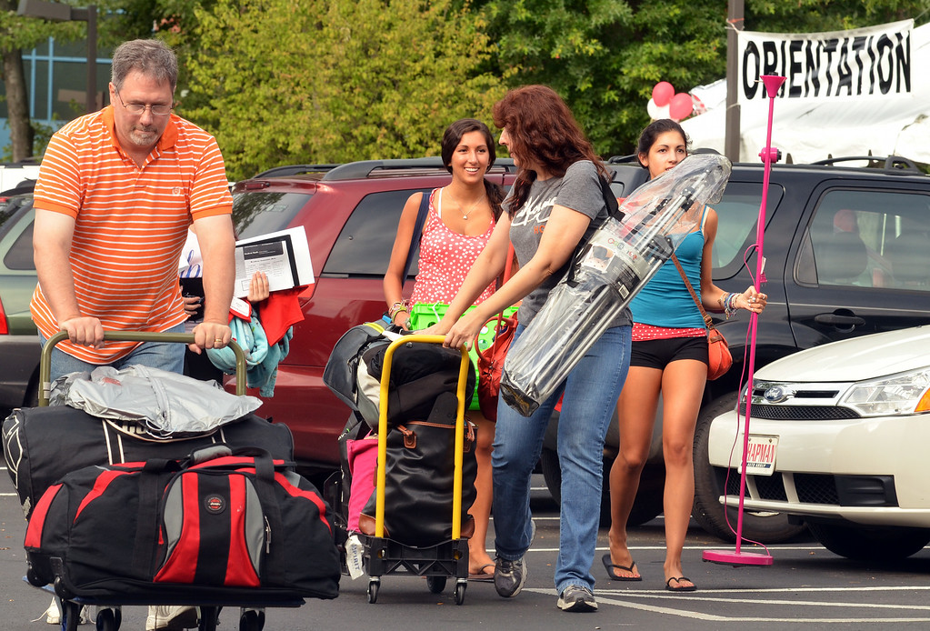 Description of . Nursing student Alyssa Gillen, second from right, moves into residence hall at Gwynedd Mercy Univesity with help from family.   Thursday, August 21, 2014.  Photo by Geoff Patton