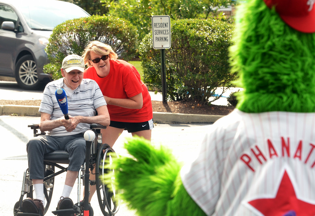 Description of . A resident takes a swing during a baseball game at the Dock Terrace Fifth Annual Senior Olympics in Towamencin.   The Philly Phanatic made a guest appearance, delivered high-fives,  posed for pictures and videos, and joined the game.    Youngsters from nearby Salford Mennonite Childcare Center finished the game begun by the seniors.    Thursday,  August 21, 2014.    Photo by Geoff Patton