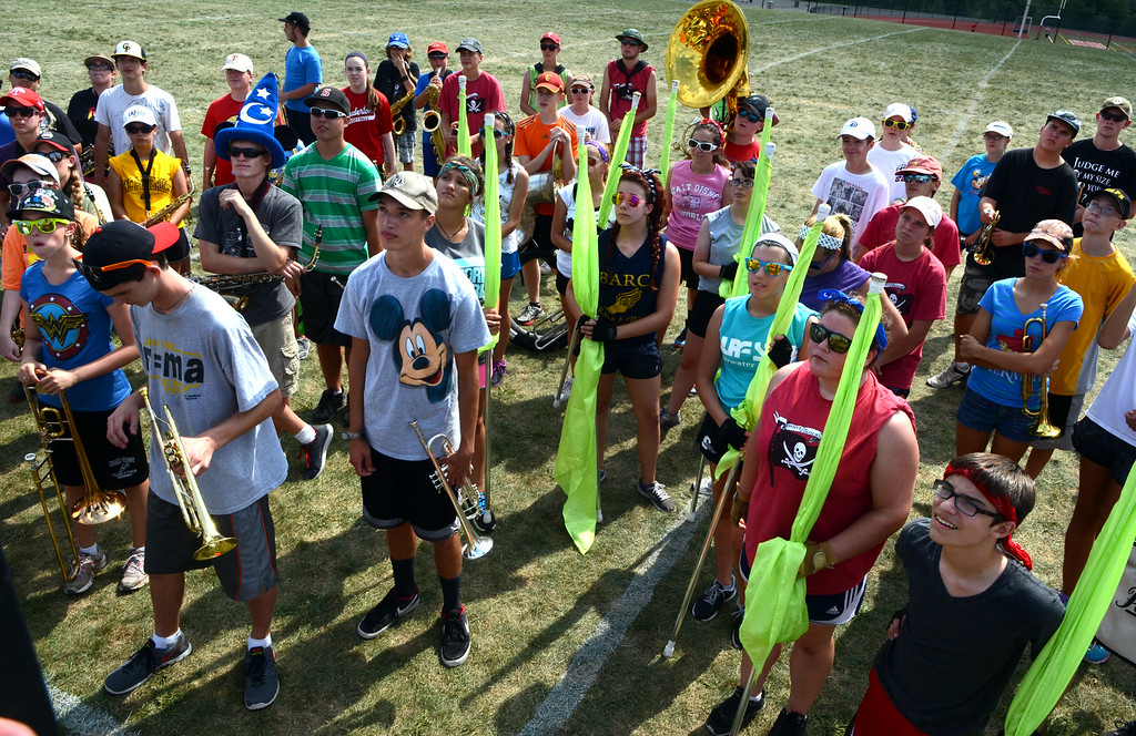 Description of . The Souderton Area High School Big Red Marching Band get instructions as they rehearse during band camp at the school on Tuesday afternon August 19,2014. Photo by Mark C Psoras/The Reporter