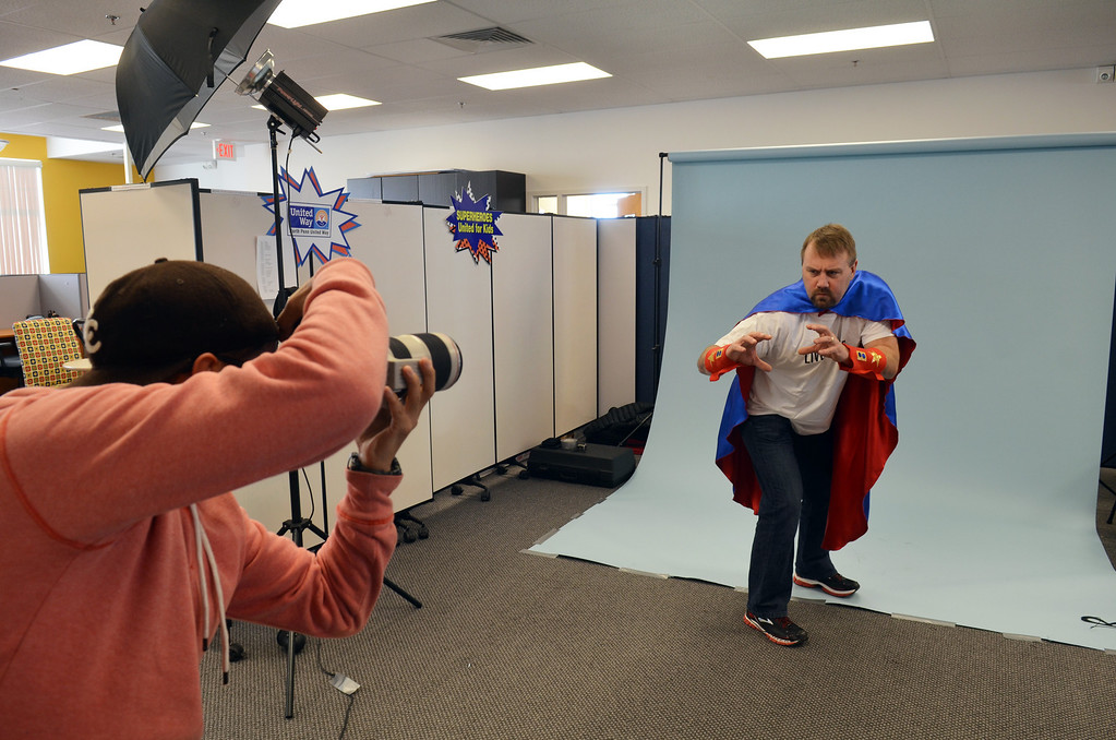 Description of . Josh Rennelss from  Clemens Family Corporation works with photographer Marco Calderon  during a shoot for the North Penn United Way's third annual Superheroes United for Kids event.   Finished photographs are used in promotion and will be  displayed during the event in April.   Friday, January 24, 2014.  Photo by Geoff Patton