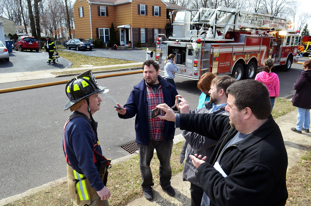 Description of . Fire marshall Mikele Waldron, left, talks to reporters at fire scene on Adams Avenue in  Hatfield Township.   Thursday,  March 27, 2014.   Photo by Geoff Patton