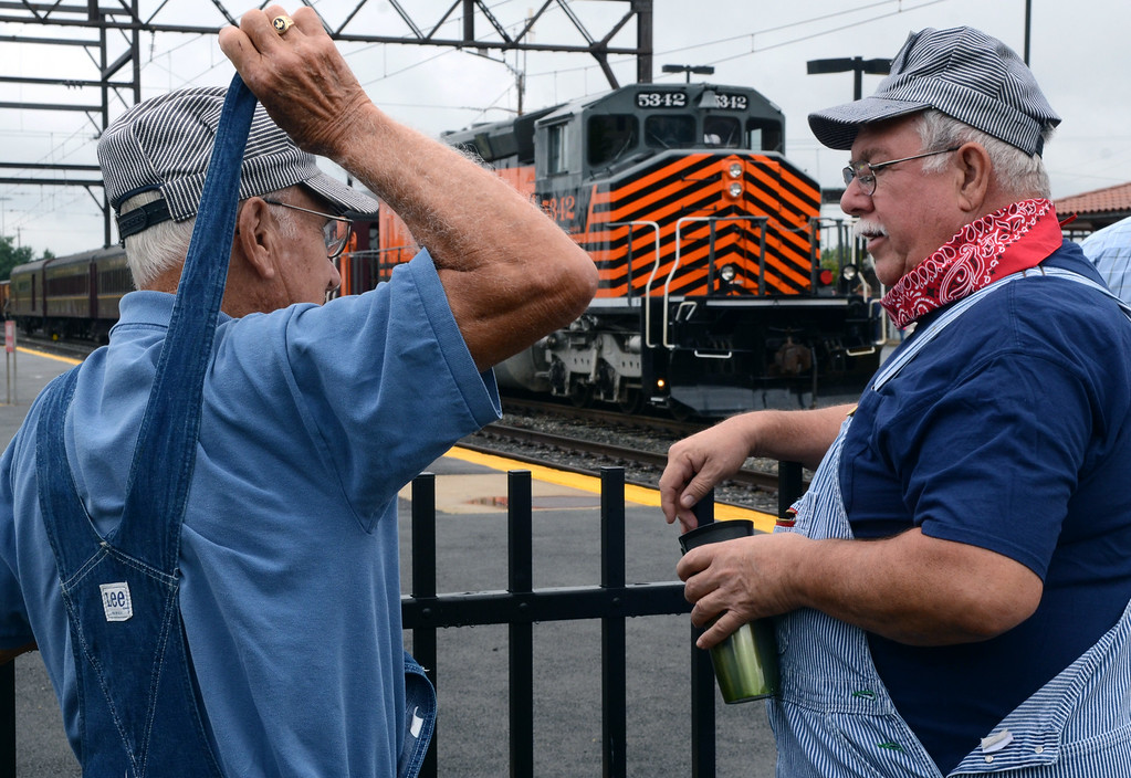 Description of . Reading Company Technical & Historical Society members Don Crabtree ,R, and Bob Francis check out the New Hope & Ivyland Excursion Train during the Lansdale Founders Day celebration and on Saturday August 23,2014. Photo by Mark C Psoras/The Reporter