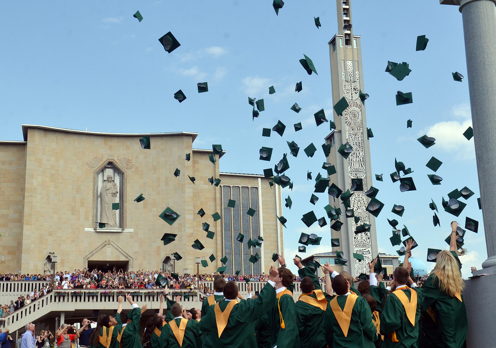 Description of . Lansdale Catholic graduates toss their caps into the air at the close of the commencement ceremony at the Shrine of Czestochowa in New Britain Township.   Tuesday, June 3, 2014.   Photo by Geoff Patton