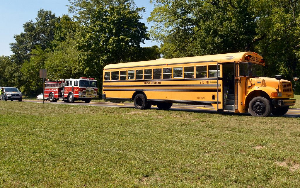 Description of . A North Penn Fire Company truck leaves the scene after firefighters extinguished a fire in the right rear wheelwell of a school bus on the shouder of Route 202 near the intersection with Meetinghouse Road in Lower Gwynedd Wednesday.   Passing motorists used knocked down the fire using extinguishers, and arriving firefighters finished the job, according to Fire Chief Chris Park.    The bus was on a practice run for the North Penn School District and was not carrying any passengers, according to spokesperson Stephanie Creech from bus operator First Student.   There were no injuries and the cause of the fire is under inverstigation, Creech said.   Wednesday, August 27, 2014.    Photo by Geoff Patton