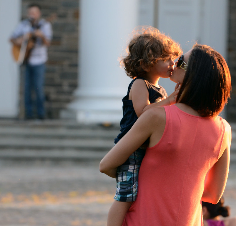 Description of . Valerie Adams gets a kiss from her son Levi ,2, as they dance around with musician Bobby Jo Valentine performing an outdoor concert on the front steps of Trinity Lutheran Church in Lansdale  on Wednesday evening August 27,2014. Photo by Mark C Psoras/The Reporter