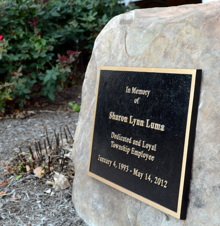 Description of . The  memorial stone and plaque dedicated to Sharon Luma, a former assistant to the Towamencin Township manager,who was killed in a motorcycle accident. Wednesday August 27,2014. Photo by Mark C Psoras/The Reporter